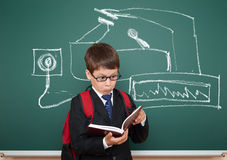 School boy read book about device painted on board Royalty Free Stock Image