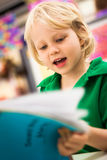 School boy reading a book Royalty Free Stock Images