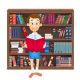 School boy reading a book and library Stock Image