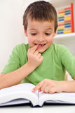 School boy with reading problems Royalty Free Stock Photo