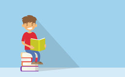 School Boy Reading Sitting on Stack Of Books Stock Photography