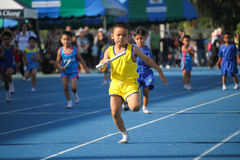 School boy is running during relay race of sport day festival Stock Images