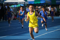 School boy is running during relay race of sport day festival Royalty Free Stock Photos
