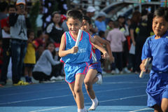 School boy is running during relay race of sport day festival Royalty Free Stock Images
