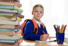 School Boy Sitting At The Desk Stock Photography