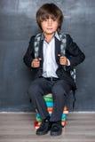 School boy sitting on books Royalty Free Stock Image