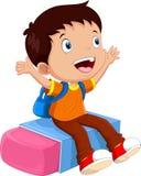 School boy sitting on an eraser Stock Images