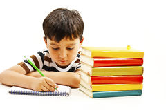 School boy sitting and writing in notebook Royalty Free Stock Photo