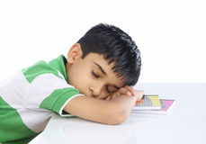 School Boy Sleeping on Book Royalty Free Stock Images