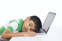 School Boy Sleeping over the laptop Stock Photos