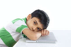 School Boy Sleeping over the laptop Royalty Free Stock Photography