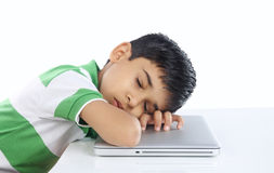 School Boy Sleeping over the laptop Stock Photography