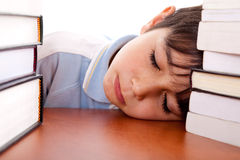 School boy sleeping on table Stock Photography