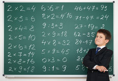 School boy solve math on board Stock Photography