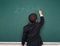 School boy solve math on school board Royalty Free Stock Photography