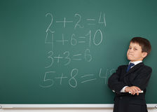 School boy solve math on school board Royalty Free Stock Photo