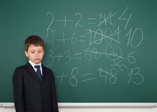 School boy solve math on school board Stock Image