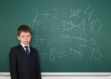 School boy solve math on school board Stock Image