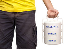 School boy standing and hold food carrier isolated Stock Photo