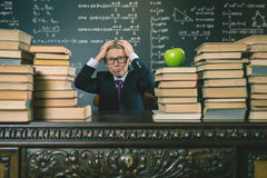 School boy in stress or depression at school classroom Stock Images