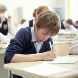 School boy struggling to finish test in class. Stock Photography