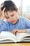 School boy studying. Serious school boy studying with a book Royalty Free Stock Images