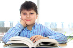 School boy studying. Happy school boy studying with a book Royalty Free Stock Image