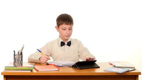 School boy taught lessons using the tablet stock video