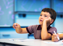School Boy thinking and dreaming. Royalty Free Stock Image