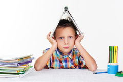 School boy is tired with lessions Stock Photo