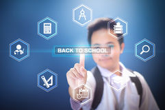 School boy touching Back to school button using Virtual Screen Hologram Stock Photography