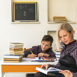 School boy and Tutor. Homework. Stock Image