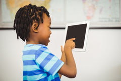 School boy using a digital tablet in classroom Royalty Free Stock Image