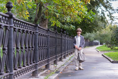 School boy walking home on a rainy autumn day. School boy walking home from his school a rainy autumn day stock photography