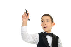 School boy wrighting with pen isolated on white Stock Image