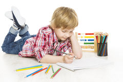School boy writing exercise in notebook. Schoolboy do homework Royalty Free Stock Images