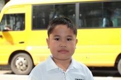 School boy with a yellow school bus Stock Photo