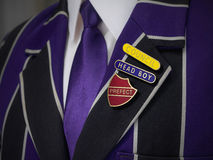School boys blazer with school badges. School boys blazer with three school badges Stock Image