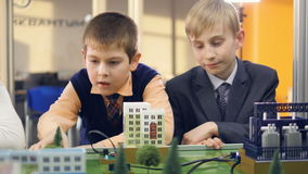 School boys in a classroom learning about renewable energy. Close-up. 4K stock video footage