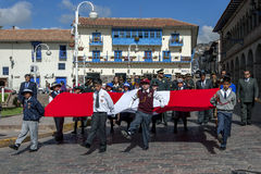 School boys in Cusco in Peru. School boys parade holding the flag of Peru at the commencement of the May Day march in Cusco in Peru Royalty Free Stock Photos