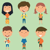 School boys and girls standing with books and backpacks. Royalty Free Stock Images