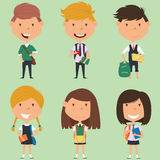 School boys and girls standing with books and backpacks. Royalty Free Stock Photos