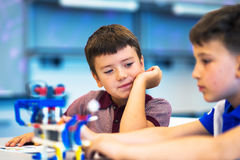 School Boys playing with construction set. Educational games for kids. Two boys playing Stock Image