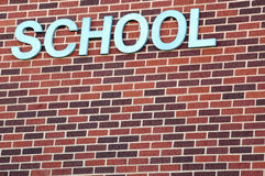 School brick wall. Brick wall with the word school on it Royalty Free Stock Image