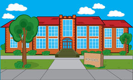 School Building. Detailed building with grass, trees, bushes etc. Could be a high school, a college or library. There's a stone plaque in front of the building Royalty Free Stock Image