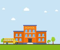 School building and bus. Front yard with trees. Stock Images