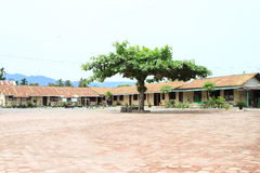 School building. Elementary school building with green tree on yard in village SP 4 Papua Barat, Indonesia Stock Image