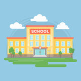 school building. Landscape with grass and clouds. Urban exterior Royalty Free Stock Photo