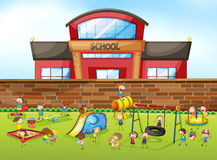 School building and playground Stock Images