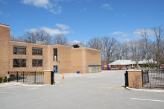 School building and schoolyard Royalty Free Stock Photos